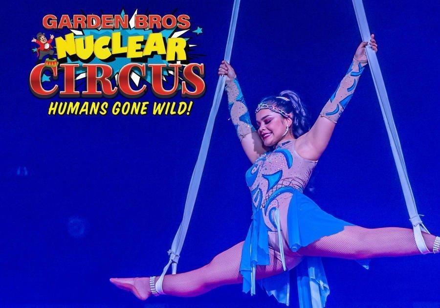 femal acrobat in blue dress
