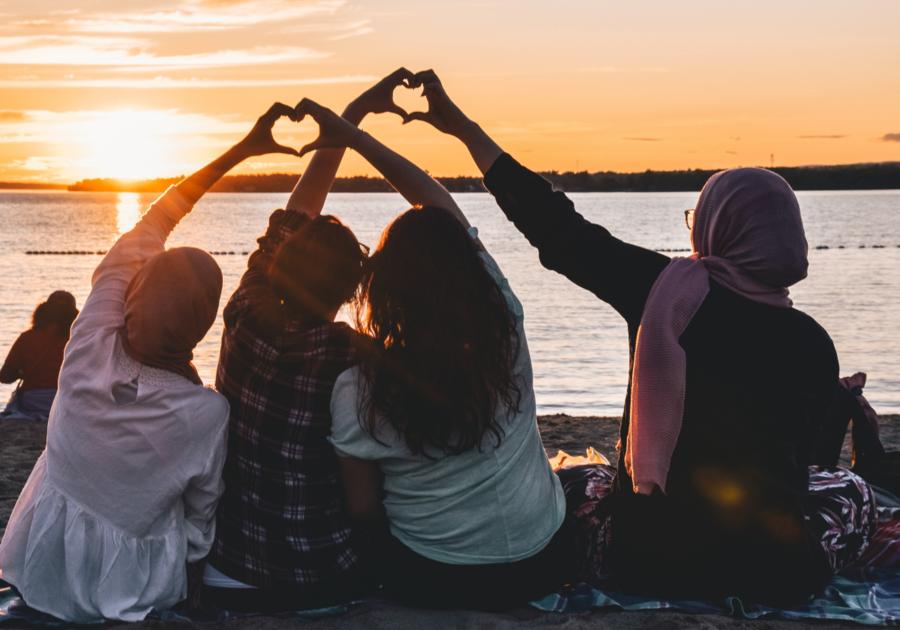 women on beach hearts
