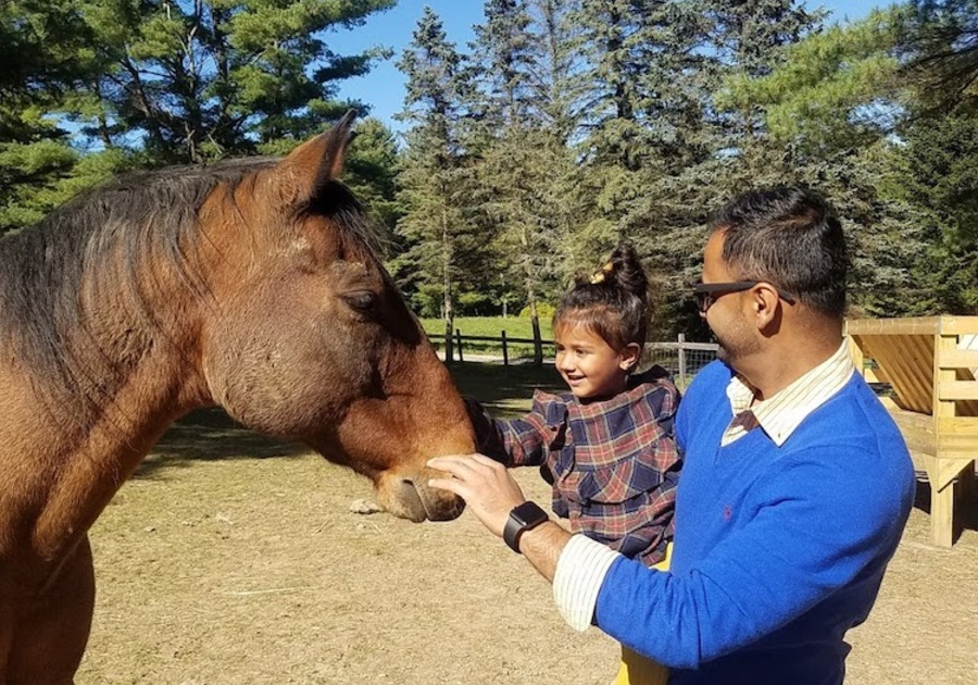 Berkshire HorseWorks father child petting horse