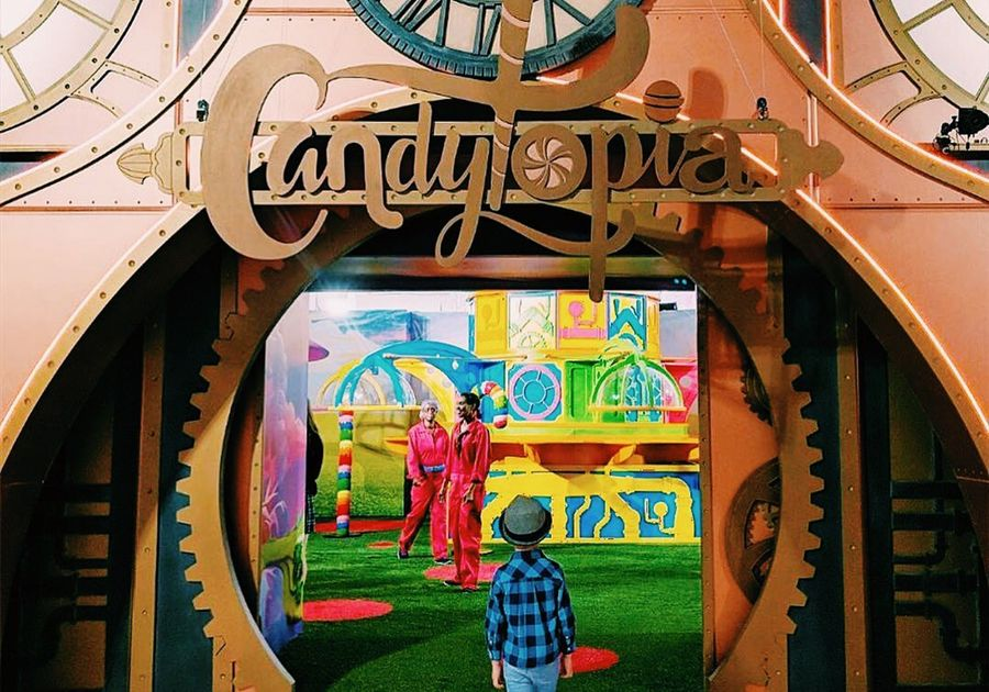 Boy at entrance of candy factory