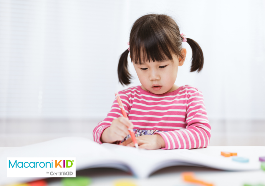 toddler girl practice writing letters for homeschooling