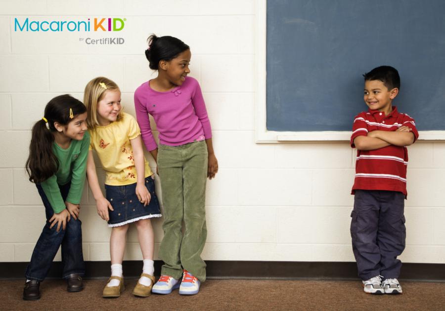 Kids in school in front of a blackboard