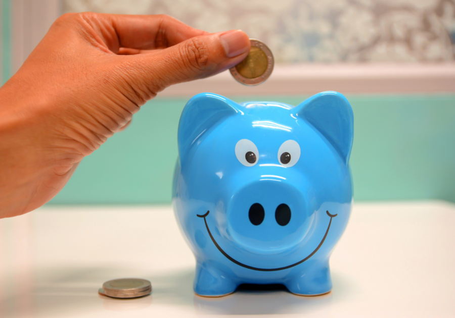 putting a coin in a piggy bank