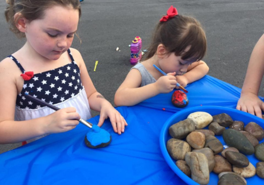 Girls painting rocks