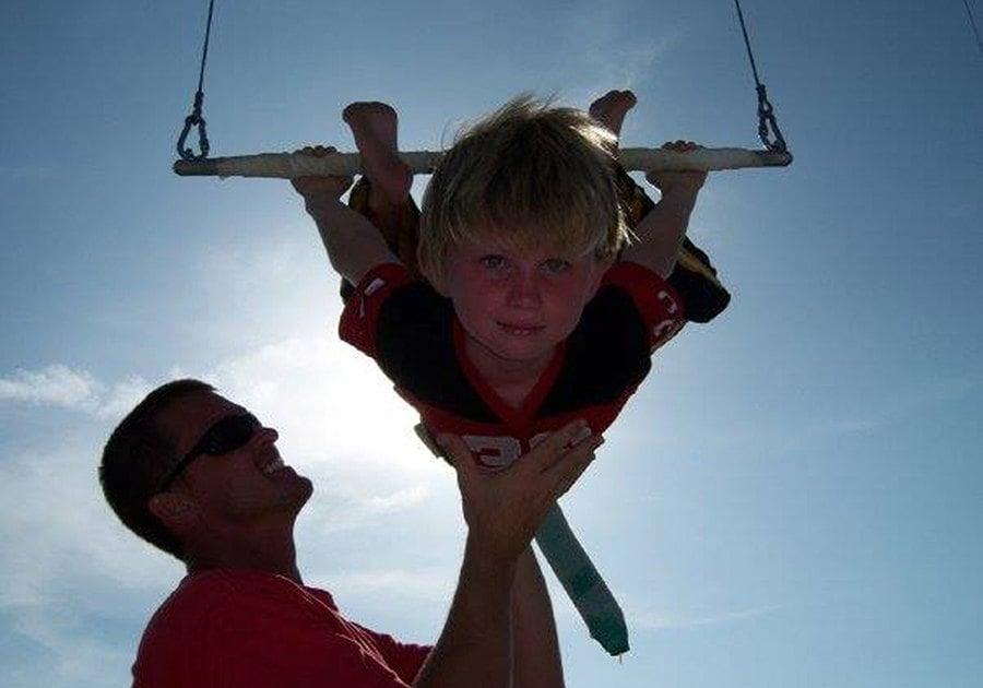 Momentum Academy student on trapeze