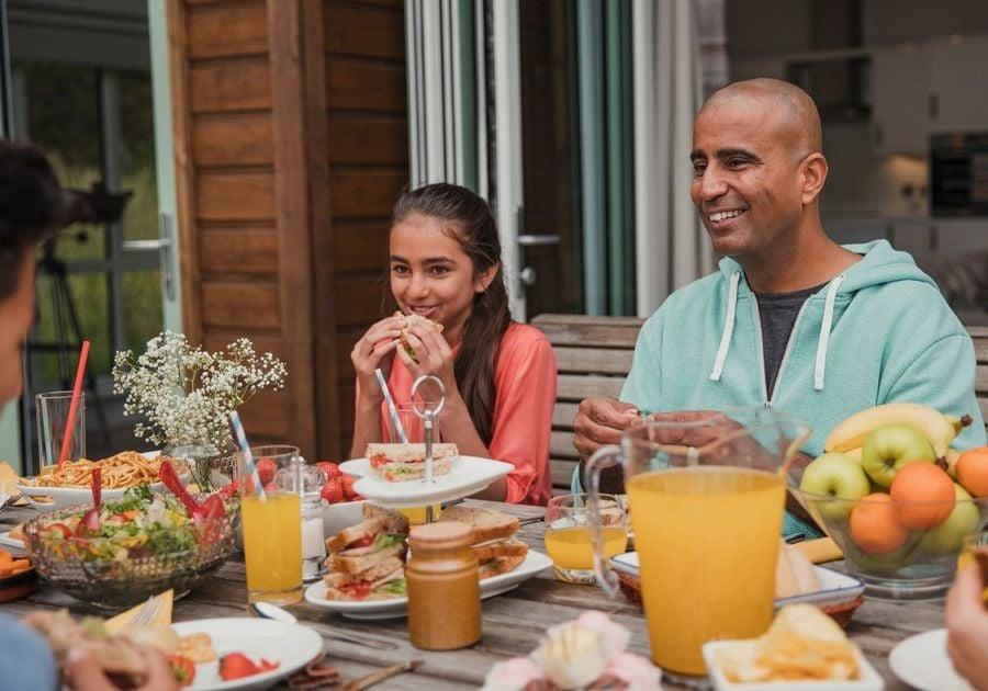 Family enjoying brunch outdoors