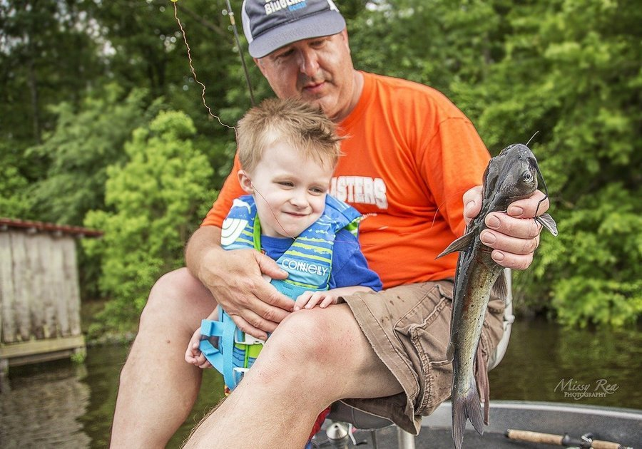 kid fishing with dad. they got one!