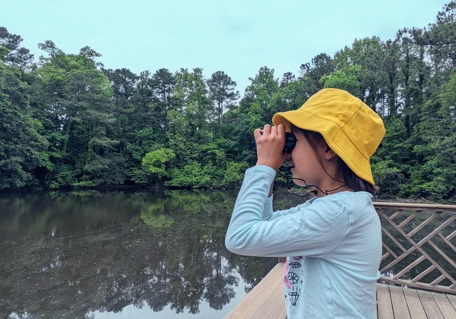 Girl looking thru binoculars