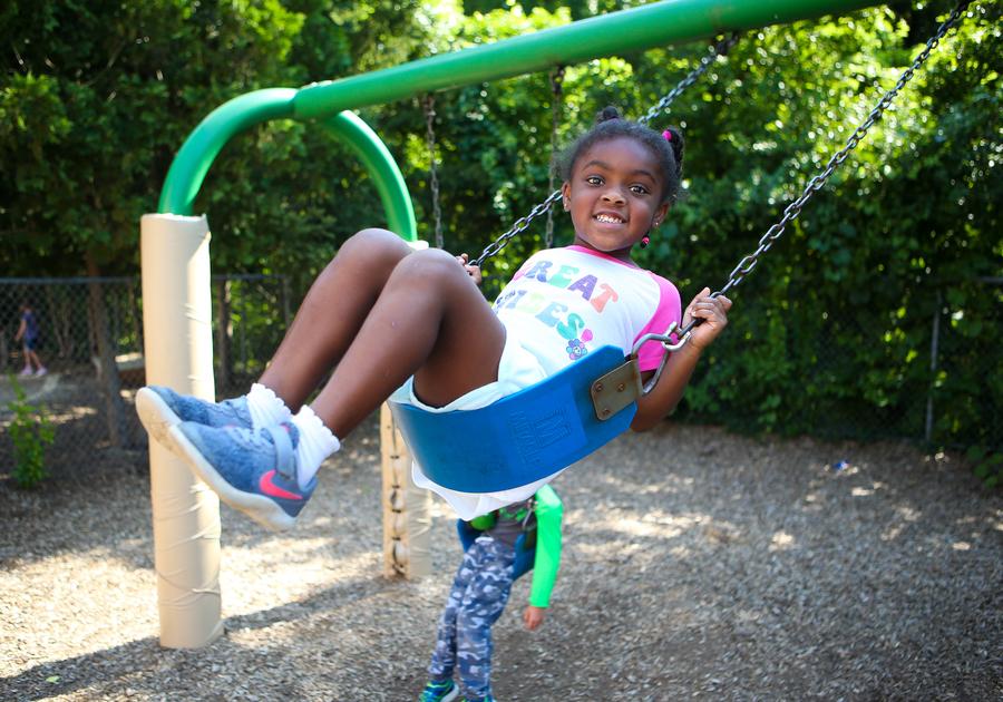 Brookside Camps Cranbrook girl swinging