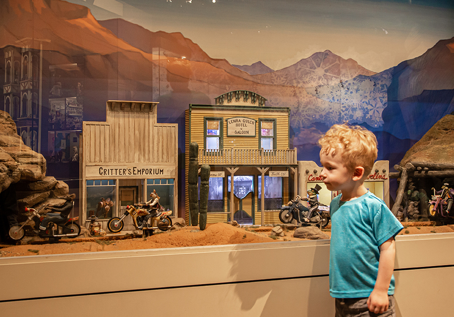 Child looking at critter motorcycles at Museum of Miniatures Tucson