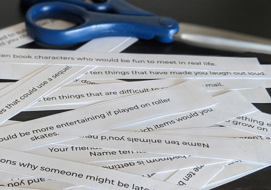 31 Prompts for Creative Conversations with Kids cut into strips with scissors nearby