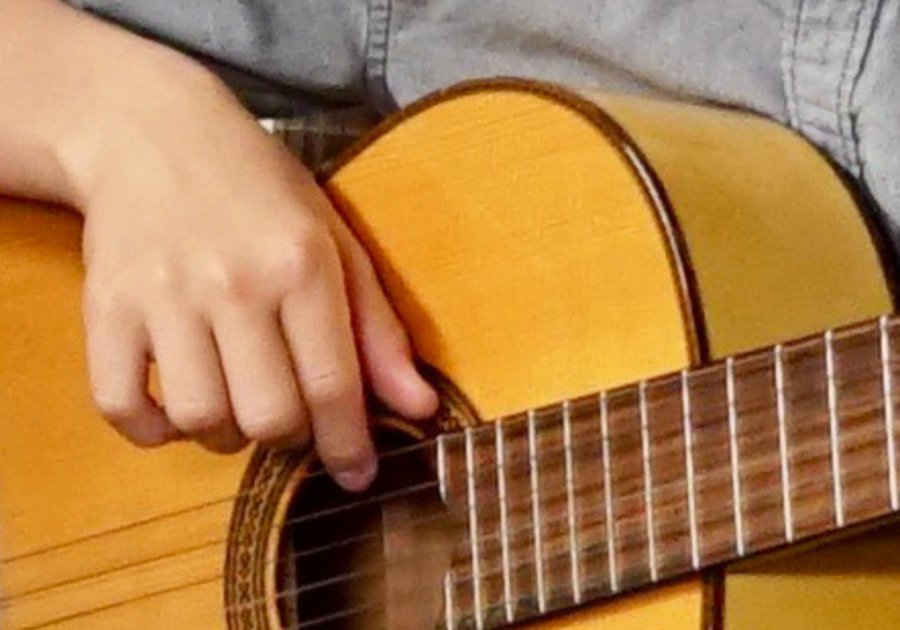 hand strumming a guitar