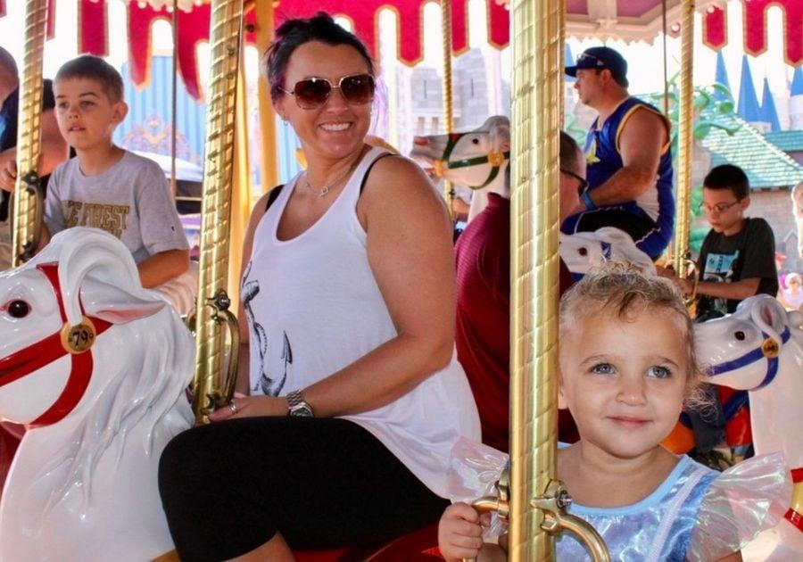 Family riding the carousel at Magic Kingdom Florida